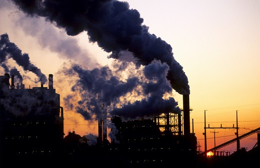 Stock Photo: 4286-90407 Smoke polluting the air from a factory