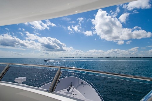 Stock Photo: 4286-90431 View from luxury power yact of Atlantic Ocean and speeding power boat, Ft. Lauderdale, FL