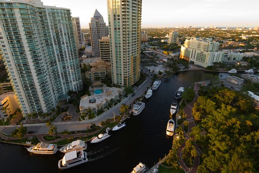 Stock Photo: 4286-90461 Highrise office towers and condominiums tower over New River in downtown Ft. Lauderdale, FL