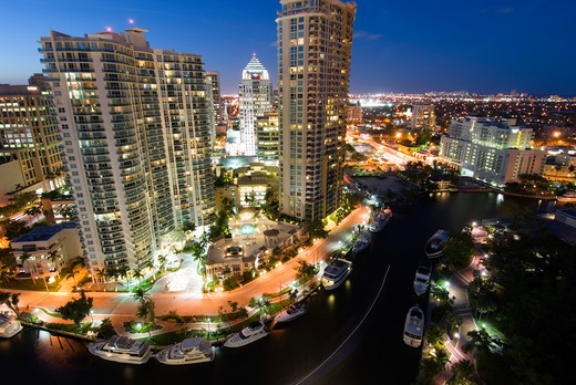 Highrise office towers and condominiums tower over New River in downtown Ft. Lauderdale, FL  : Stock Photo