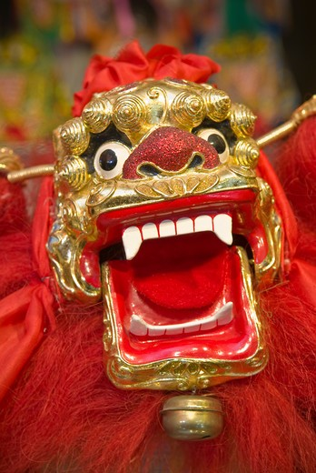Gold inlaid dragon hand puppet in Jinshow Zhuang puppet store and museum, Quanzhou, Fujian Province, China  : Stock Photo