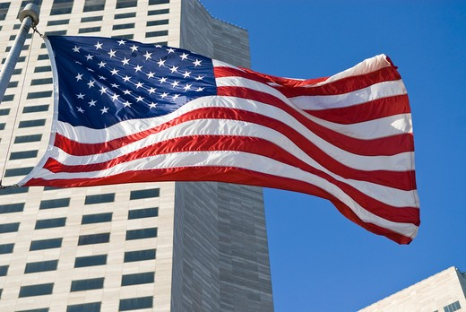 Stock Photo: 4286-90611 American flag ripples in wind below highrise downtown buildings, Miami, Florida