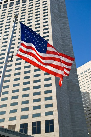 Stock Photo: 4286-90612 American flag ripples in wind below highrise downtown buildings, Miami, Florida