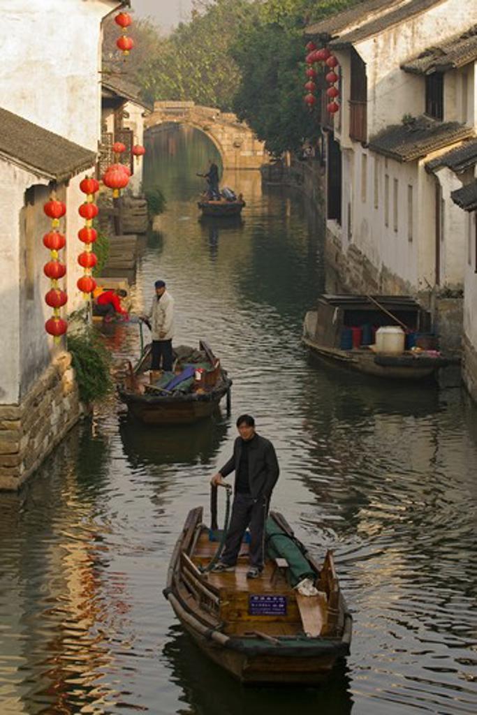 Stock Photo: 4286-90633 Row boat on canal of historic water town, Zhouzhuang, Jiangsu Province, China