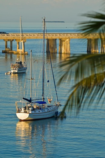 Stock Photo: 4286-90652 Sail boats anchor at sunset alongside Overseas Highway, Bahia Honda State Park, the Florida Keys, Florida