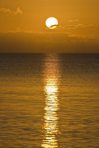 Setting orange sun shimmers over endless ocean, Bahia Honda State Park, Florida Keys, Florida : Stock Photo