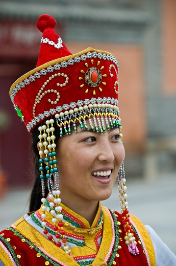 Stock Photo: 4286-90803 Chinese tourist has her picture taken in ethnic Mongolian costume, Xilinhot, Inner Mongolia, China