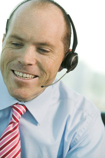 Stock Photo: 4286R-10832 Businessman with cordless headset.  PR