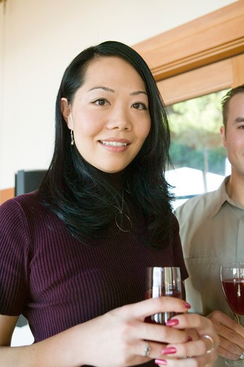Stock Photo: 4286R-11980 Asian Friends With a Glass of Wine, MR-0560 MR-0564 PR-0505