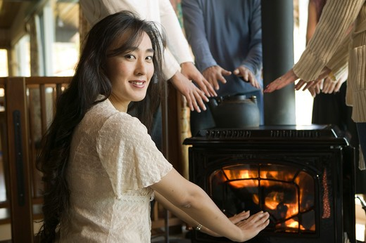 Stock Photo: 4286R-12014 Friends Getting Warm Around a Wood Stove, MR-0560 MR-0561 MR-0562 MR-0563 MR-0564 PR-0505
