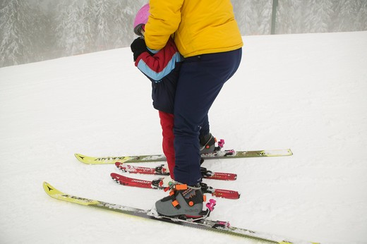 Mom Teaching 4 Year Old Daughter to Ski, Grouse Mountain North Vancouver BC Canada, MR-0601 MR-0602 : Stock Photo