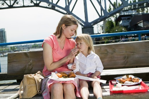 Mom And Daughter Having a Fish and Chips Lunch on Granville Island Vancouver, MR-0601 MR-0637 : Stock Photo