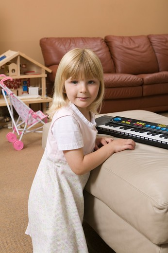 Stock Photo: 4286R-12554 Young Girl With a Small Keyboard, MR-0654 PR-0655