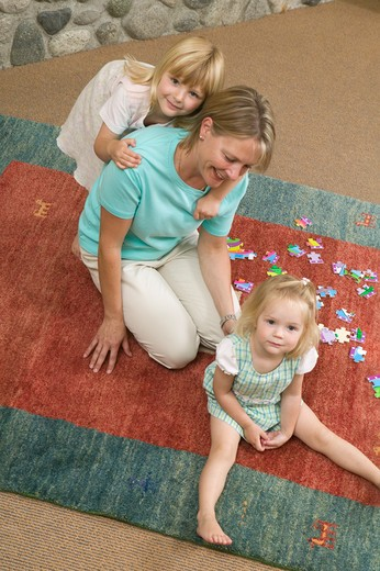 Mom and Daughters With a Jigsaw Puzzle, MR-0652 MR-0653 MR-0654 PR-0655 : Stock Photo