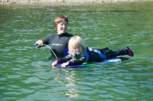 Stock Photo: 4286R-12629 Mom and Daughter Wearing Wetsuits in Cold Water, MR-0601 MR-0602