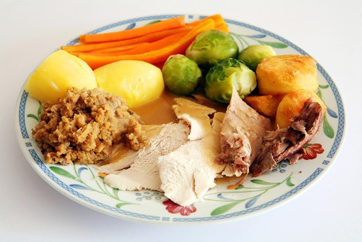Stock Photo: 4286R-1273 A plate of festive favourites: turkey, roast potato, brussels sprouts, boiled potato, gravy and stuffing.