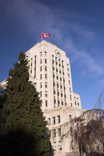 Stock Photo: 4286R-13041 Vancouver City Hall with Canada Flag standing proud on blue sky - Vancouver BC