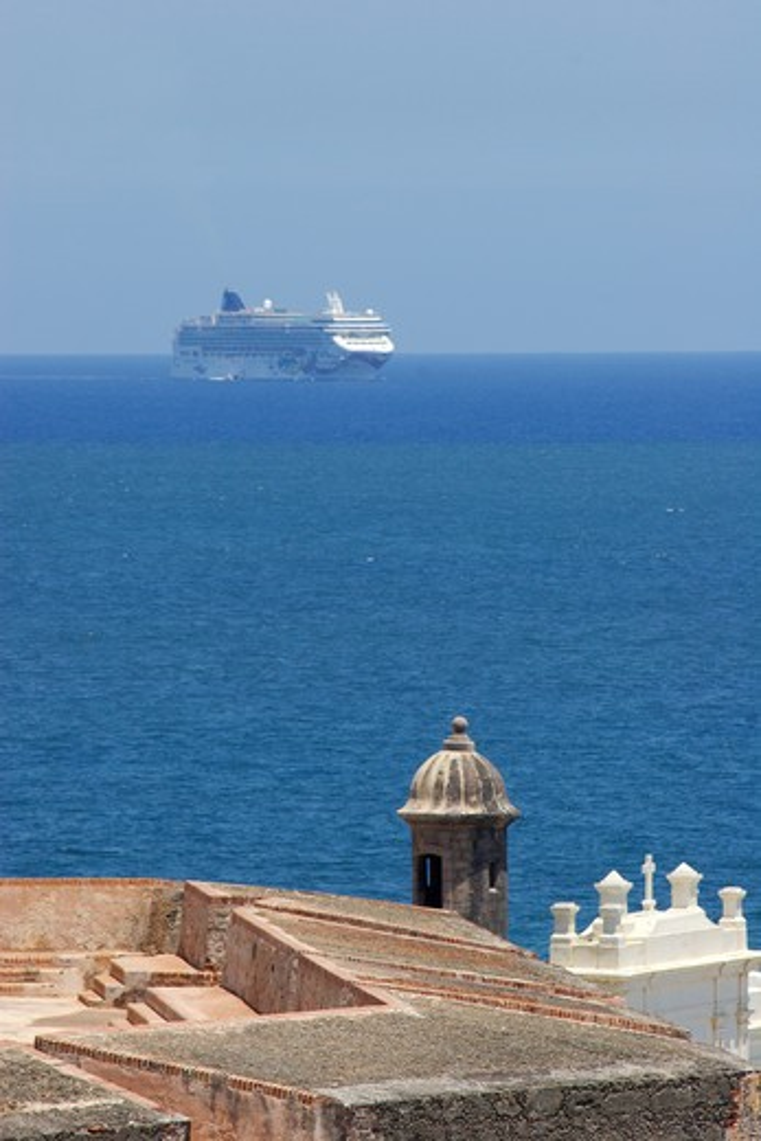 Stock Photo: 4286R-13181 Cruise ship appears behind the Castillo de San Felipe del Morro in old San Juan, Puerto Rico