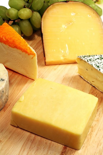 A well-supplied gourmet cheeseboard with cheddar to the fore. : Stock Photo