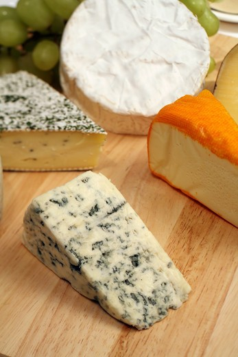 Stock Photo: 4286R-1328 A cheeseboard, Danish blue to the front, with a selection of gourmet cheeses