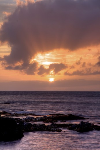 Stock Photo: 4286R-13605 Light rays emanating from setting sun as waves break, Maui