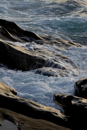 Waves flowing over smoothed stone, west coast of Cape Breton Island, Nova Scotia, Canada : Stock Photo