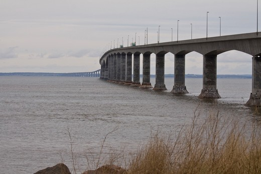 Stock Photo: 4286R-14074 Trucks drive across the 13 Km long Confederation Bridge, linking Prince Edward Island to New Brunswick, Canada