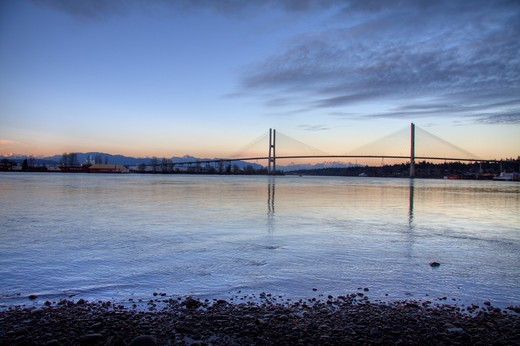 Stock Photo: 4286R-14360 Alex Fraser Bridge over the Fraser River at sunset, Delta, BC, Canada
