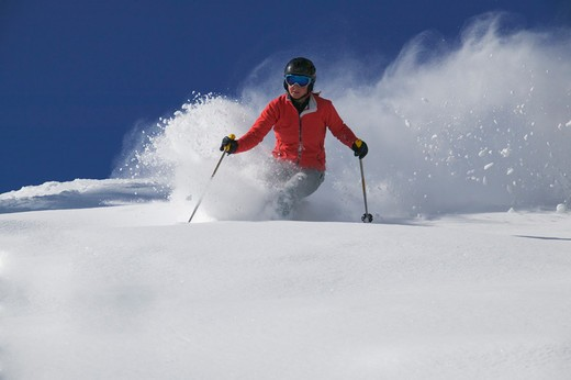 A young woman skiing powder snow in Lake Tahoe, CA. : Stock Photo