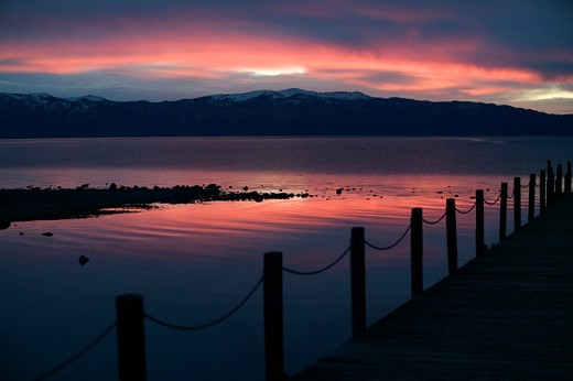 Stock Photo: 4286R-14542 Sunrise over a dock on Lake Tahoe, CA.