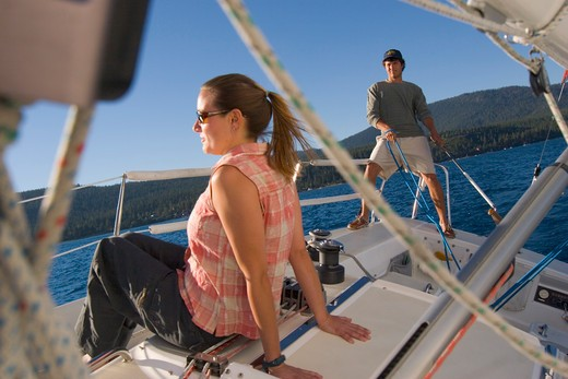 Stock Photo: 4286R-14785 A Couple Sailing on Lake Tahoe