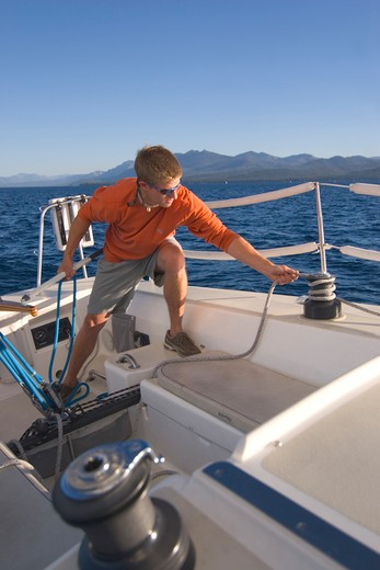 Stock Photo: 4286R-14793 A Man Sailing on Lake Tahoe
