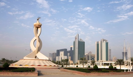 Stock Photo: 4286R-1485 The Oryx monument on the edge of the business tower New District of Doha, backed by new tower blocks. November 18, 2007