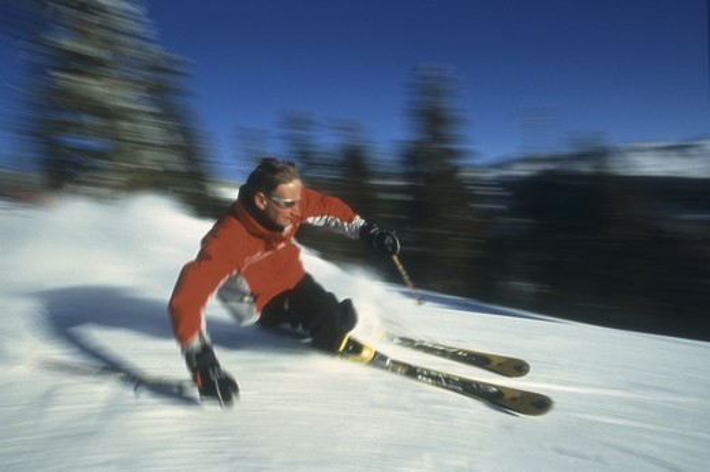 A man skiing fast a Diamond Peak near Lake Tahoe in California. : Stock Photo