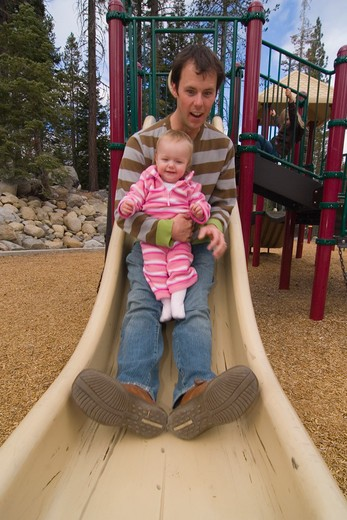 Stock Photo: 4286R-15168 A father and child playing in a playground near Squaw Valley California