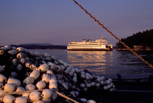 Stock Photo: 4286R-16160 A ferry from the Washington State ferry system and fishing nets at sunset in Friday Harbor in the San Juan Islands Washington