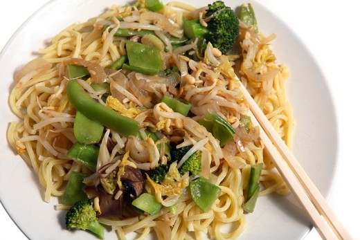 Stock Photo: 4286R-1686 A meal of vegetarian stir-fried chow mein, with broccoli,noodles,beansprouts, mangetout, capsicums etc.