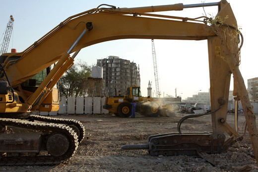 Heavy machinery on site during the demolition of the Musheireb area of central Doha, Qatar, in November 2009, to make way for a major rebuilding programme. : Stock Photo
