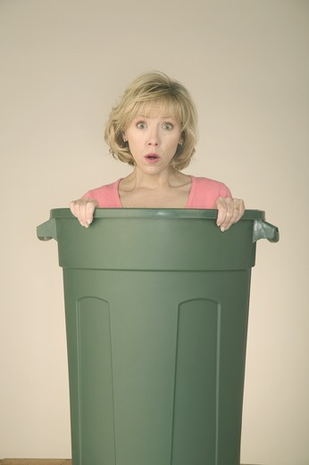 Stock Photo: 4286R-2369 Woman with her green trash can