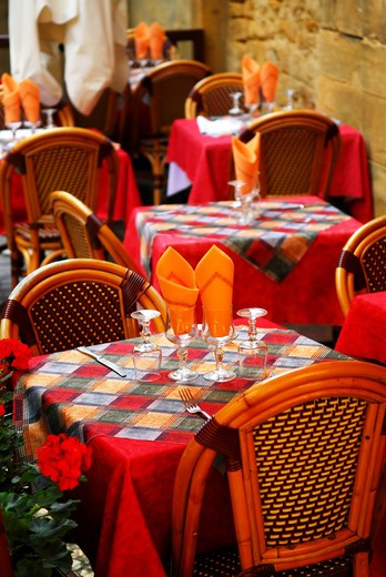 Set tables with tablecloth and glasses on restaurant outdoor patio : Stock Photo