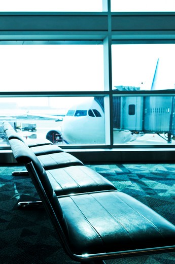 Stock Photo: 4286R-3156 Waiting area of airport gate with airplane outside