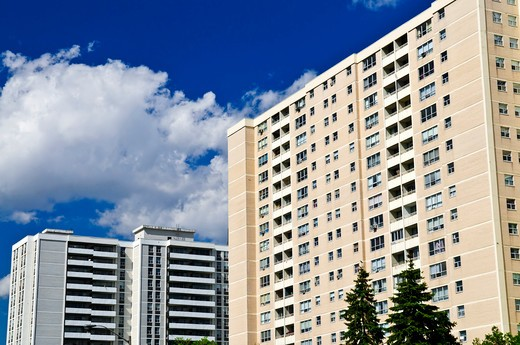 Tall residential apartment buildings with blue sky : Stock Photo