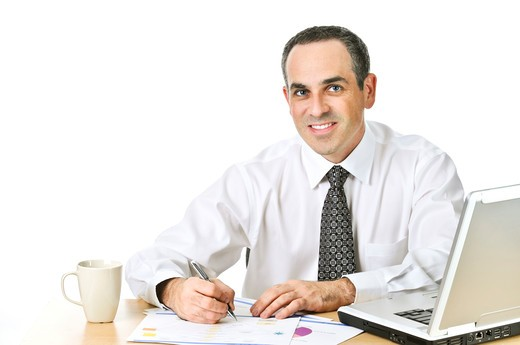 Stock Photo: 4286R-4165 Happy office worker reviewing generic reports at his desk