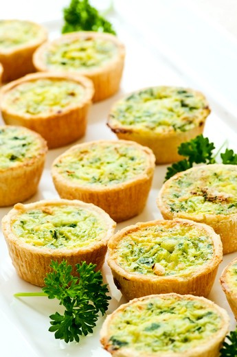Stock Photo: 4286R-4499 Plate of many mini bite size quiche appetizers