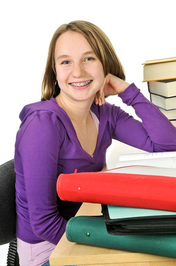 Stock Photo: 4286R-4512 Happy teenage girl studying at the desk