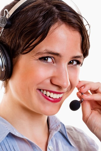 Stock Photo: 4286R-4631 business - young brunette woman with headset on her head