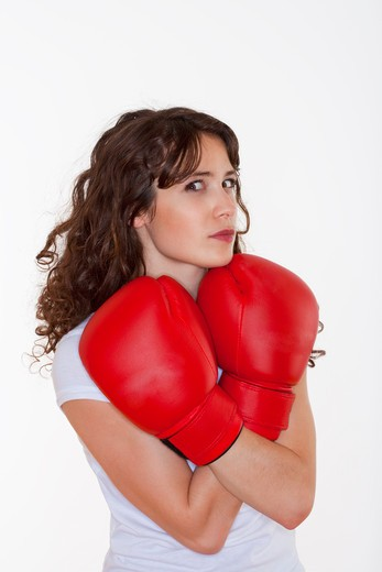Stock Photo: 4286R-4803 young brunette woman with red boxing gloves