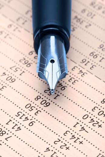 extreme closeup of a fountain pen and charts : Stock Photo