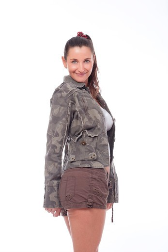 woman with brown hair in shorts and streetware jacket - isolated on white : Stock Photo