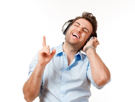 Stock Photo: 4286R-5729 man in blue shirt with earphones listening to music - isolated on white